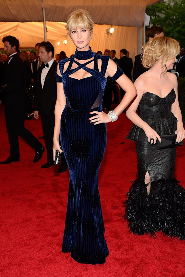 "<p class=""MsoNormal"">Real estate heiress Ivanka Trump showed off a sizzling blond bombshell look at the 2012 Met Costume Institute Gala in NYC on Monday night, debuting her recently lightened locks and new, thick bangs. The 30-year-old revealed the hairstyle to her more than 1.3 million Twitter followers prior to the big event,<a target=""_blank"" href=""http://instagr.am/p/KV0lQ9ikP8/""> tweeting a photo of just her face</a> along with the word ""Bangs!"" She may have given birth to daughter Arabella Rose just 10 months ago, but you'd never know it by the fabulous figure she flaunted in this form-fitting Peter Pilotto gown. </p>"