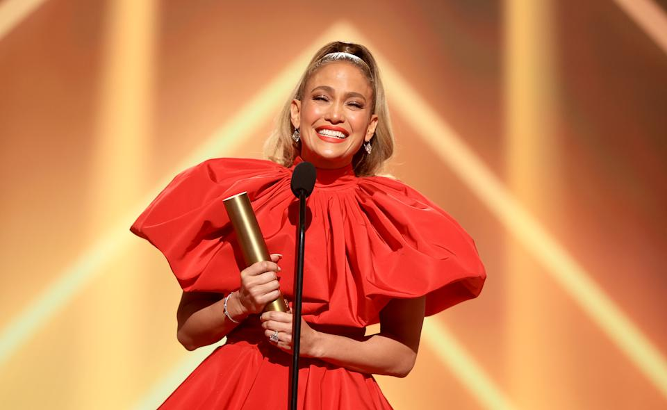 SANTA MONICA, CALIFORNIA - NOVEMBER 15: 2020 E! PEOPLE'S CHOICE AWARDS -- In this image released on November 15, Jennifer Lopez, People's Icon of 2020, accepts the award onstage for the 2020 E! People's Choice Awards held at the Barker Hangar in Santa Monica, California and on broadcast on Sunday, November 15, 2020. (Photo by Christopher Polk/E! Entertainment/NBCU Photo Bank via Getty Images)