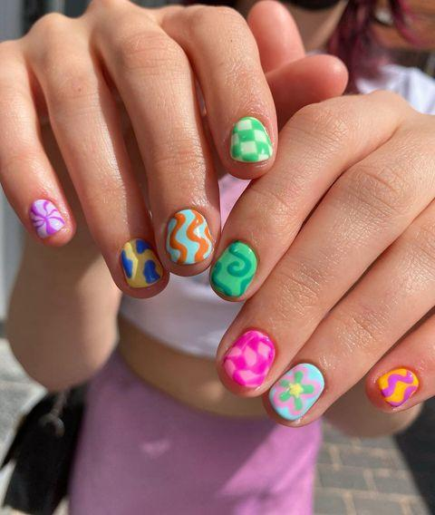 """<p>We are OBSESSED with these pick 'n mix nails by <a href=""""https://www.instagram.com/nails.bab/"""" rel=""""nofollow noopener"""" target=""""_blank"""" data-ylk=""""slk:@nails.bab"""" class=""""link rapid-noclick-resp"""">@nails.bab</a> which are giving us all the Lizzie McGuire vibes. </p><p><a href=""""https://www.instagram.com/p/CQPAOdmslt6/"""" rel=""""nofollow noopener"""" target=""""_blank"""" data-ylk=""""slk:See the original post on Instagram"""" class=""""link rapid-noclick-resp"""">See the original post on Instagram</a></p>"""
