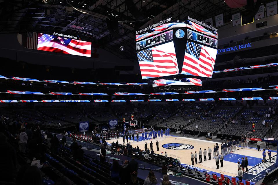 The national anthem is played before a game between the New Orleans Pelicans and the Dallas Mavericks in the first quarter at American Airlines Center on February 12, 2021 in Dallas, Texas. NOTE TO USER: User expressly acknowledges and agrees that, by downloading and/or using this Photograph, User is consenting to the terms and conditions of the Getty Images License Agreement.  (Photo by Ronald Martinez/Getty Images)