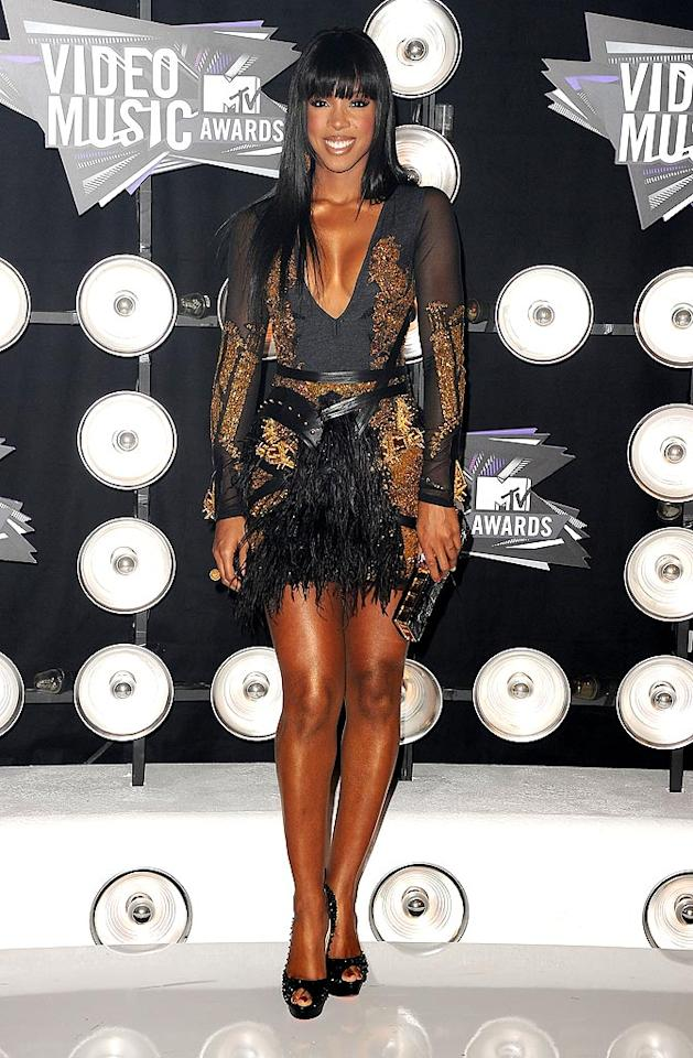 "While Beyonce was all covered up, her ex Destiny's Child bandmate Kelly Rowland was in the mood to show off a little skin! The ""Motivation"" songstress strutted her stuff in an embellished mini and studded pumps. Jason Merritt/<a href=""http://www.gettyimages.com/"" target=""new"">GettyImages.com</a> - August 28, 2011"