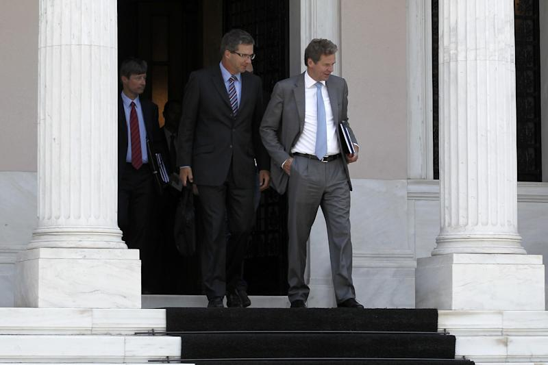 Poul Thomsen, the International Monetary Fund mission chief in Greece, right, Klaus Masuch of the European Central Bank, center, and European Commission official Matthias Mors leave the Maximou mansion after a meeting with Greek Prime Minster Antonis Samaras, in Athens, Monday, Sept 10, 2012. Greece's prime minister held new negotiations Monday with representatives of the country's bailout creditors who are demanding a fresh round of austerity cuts that have raised the ire of public servants from professors and judges to police and tax collectors. (AP Photo/Petros Giannakouris)