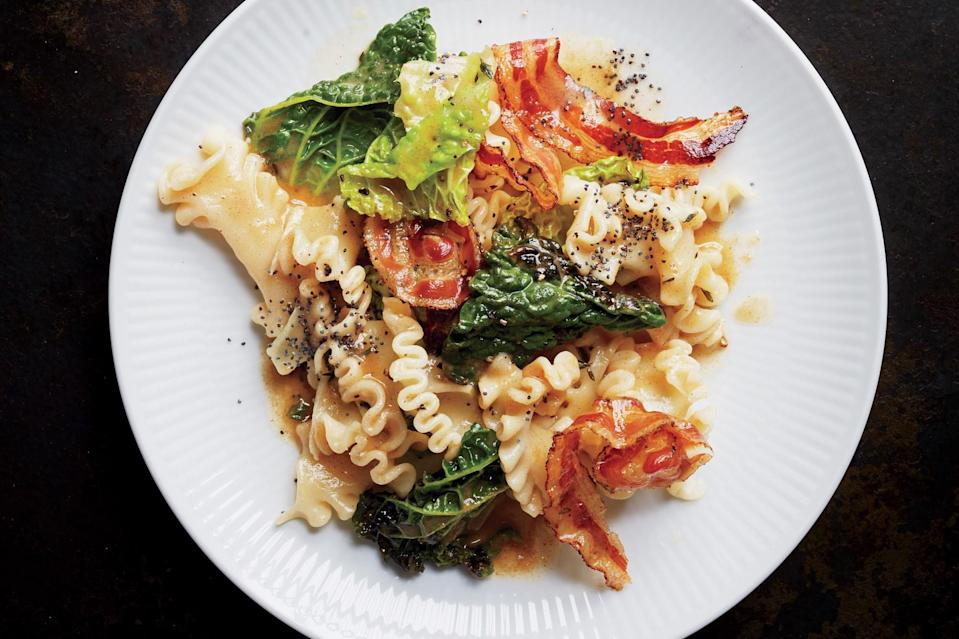 "We're into the ruffles-on-ruffles look you get from using reginetti noodles and Savoy cabbage, but any short pasta and green cabbage can be used in their place. <a href=""https://www.epicurious.com/recipes/food/views/reginetti-with-savoy-cabbage-and-pancetta-51264250?mbid=synd_yahoo_rss"" rel=""nofollow noopener"" target=""_blank"" data-ylk=""slk:See recipe."" class=""link rapid-noclick-resp"">See recipe.</a>"