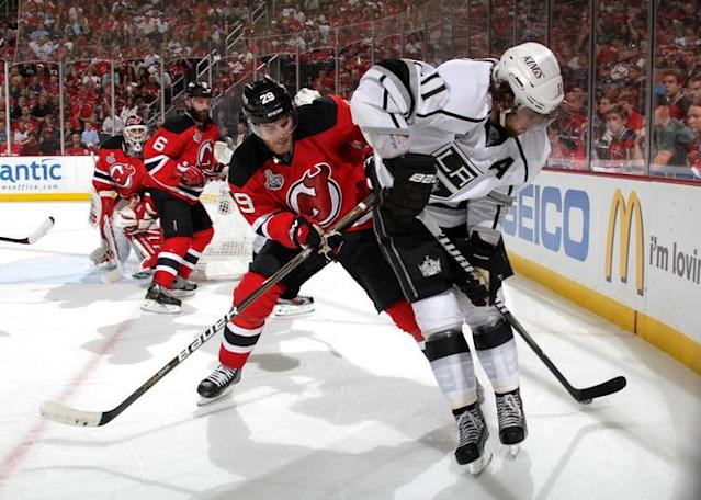 NEWARK, NJ - JUNE 02: Mark Fayne #29 of the New Jersey Devils and Anze Kopitar #11 of the Los Angeles Kings fight for a loose puck during Game Two of the 2012 NHL Stanley Cup Final at the Prudential Center on June 2, 2012 in Newark, New Jersey. (Photo by Bruce Bennett/Getty Images)
