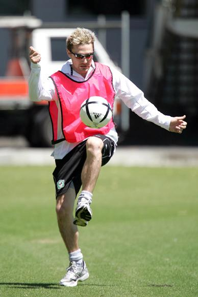 AUCKLAND, NEW ZEALAND - FEBRUARY 15: Black Cap cricketer Brendan McCullum knees the soccer ball during a warm up drill at their practice session at Eden Park in Auckland, Tuesday, February 15th, 2005. (Photo by Sandra Mu/Getty Images)