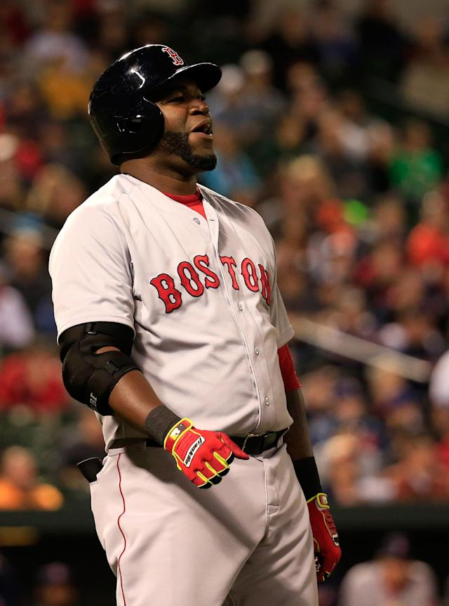 BALTIMORE, MD - APRIL 02: David Ortiz #34 of the Boston Red Sox reacts after flying out for the second out of the ninth inning against the Baltimore Orioles during the Red Sox 6-2 win at Oriole Park at Camden Yards on April 2, 2014 in Baltimore, Maryland. (Photo by Rob Carr/Getty Images)