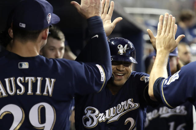 Milwaukee Brewers' Trent Grisham is congratulated after hitting a solo home run during the first inning inning of the team's baseball game against the Miami Marlins, Wednesday, Sept. 11, 2019, in Miami. (AP Photo/Lynne Sladky)