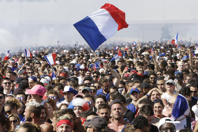 <p>French soccer fans watch a live broadcast on a big screen of the final match between France and Croatia at the 2018 soccer World Cup, in Marseille, southern France, Sunday, July 15, 2018. (AP Photo/Claude Paris) </p>