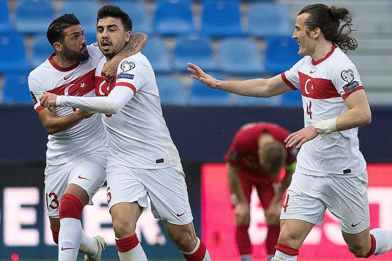 Ozan Tufan, centre, and Caglar Soyuncu, right, scored Turkey's goals against Norway