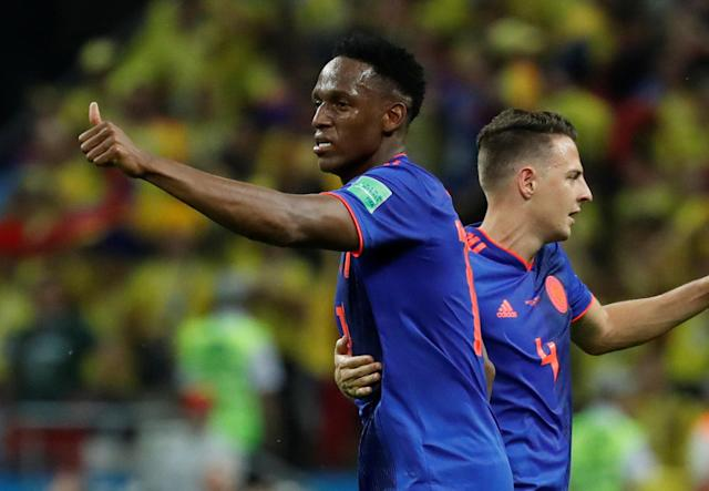 Soccer Football - World Cup - Group H - Poland vs Colombia - Kazan Arena, Kazan, Russia - June 24, 2018 Colombia's Yerry Mina celebrates scoring their first goal with Santiago Arias REUTERS/Toru Hanai