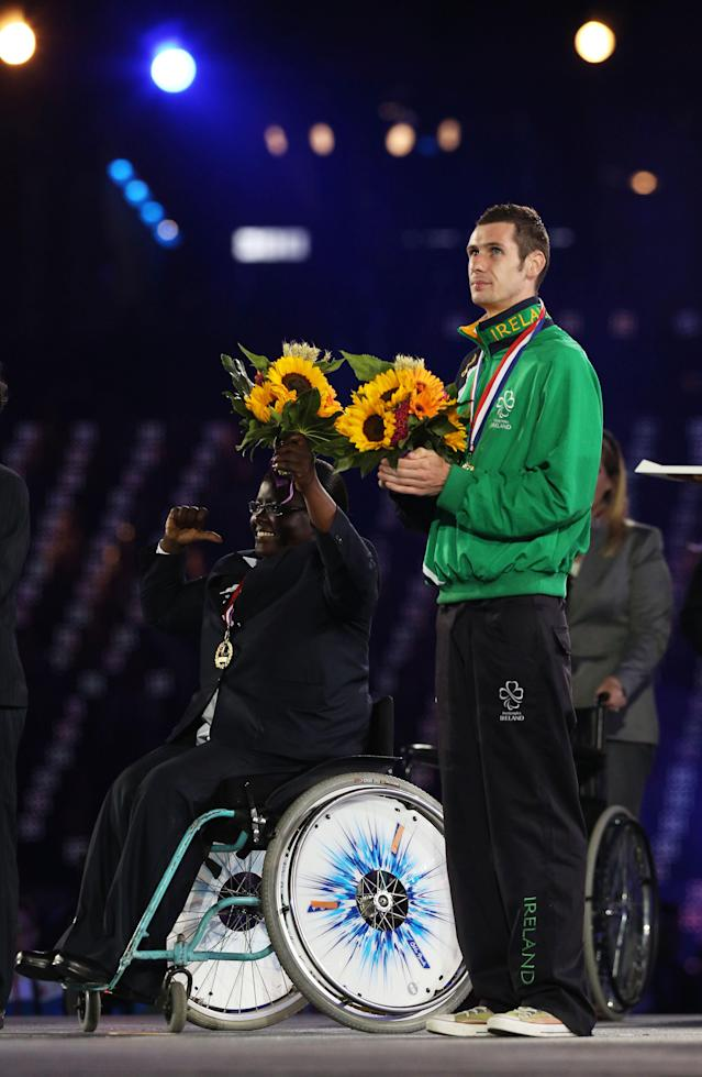 LONDON, ENGLAND - SEPTEMBER 09: Paralympians Michael McKillop of Ireland and Mary Zakayo receive the Whang Youn Dai award during the closing ceremony on day 11 of the London 2012 Paralympic Games at Olympic Stadium on September 9, 2012 in London, England. (Photo by Peter Macdiarmid/Getty Images)