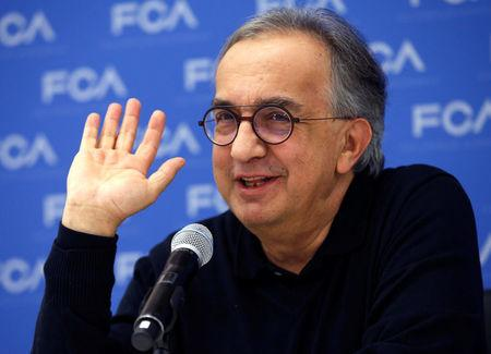 FILE PHOTO: Sergio Marchionne, CEO, Fiat Chrysler Automobiles, speaks with journalists at the North American International Auto Show in Detroit, Michigan, U.S., January 15, 2018. REUTERS/Rebecca Cook/File Photo