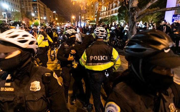 Demonstrators and police officers face off - Bloomberg