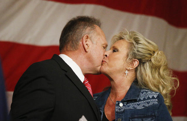 Senate candidate Roy Moore kisses his wife, Kayla Moore, after he speaks at a campaign rally this week in Fairhope, Ala. (Photo: Brynn Anderson/AP)