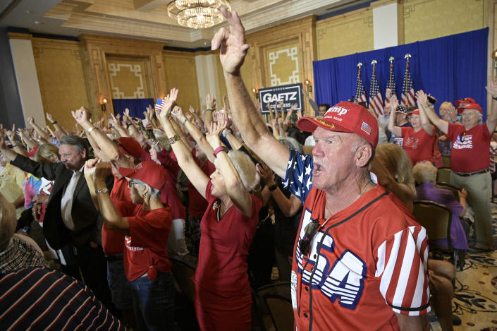 Attendees cheer during a rally featuring Rep. Matt Gaetz, R-Fla. and Rep. Marjorie Taylor Greene, R-Ga., Friday, May 7, 2021, in The Villages, Fla. (AP Photo/Phelan M. Ebenhack)