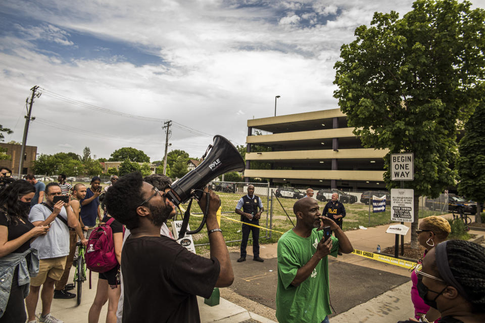 Tensions rise between protesters and police officers who were investigating a fatality in an officer involved shooting, Thursday, June 3, 2021 in Minneapolis. One person was killed Thursday when authorities who were part of a task force that included U.S. Marshals fired their weapons after the person displayed a handgun in Minneapolis' Uptown neighborhood, the U.S. Marshals said. (Richard Tsong-Taatarii/Star Tribune via AP)
