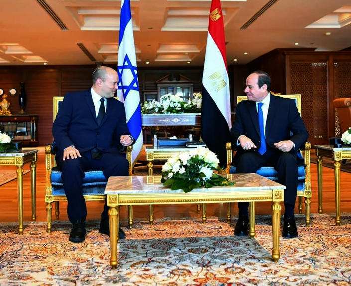 In this photo provided by Egypt's presidency media office, Egyptian President Abdel-Fattah el-Sissi, right, meets with Israeli Prime Minister Naftali Bennett in the Red Sea resort of Sharm el-Sheikh, Egypt, Monday, Sept. 13, 2021. This is the first official visit by an Israeli premier since 2010, when then-President Hosni Mubarak hosted a summit with Benjamin Netanyahu, Palestinian President Mahmoud Abbas and U.S. Secretary of State Hillary Clinton. (Egyptian Presidency Media office via AP)