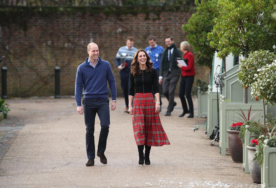 The Duke and Duchess of Cambridge arrive for the Christmas party (PA)