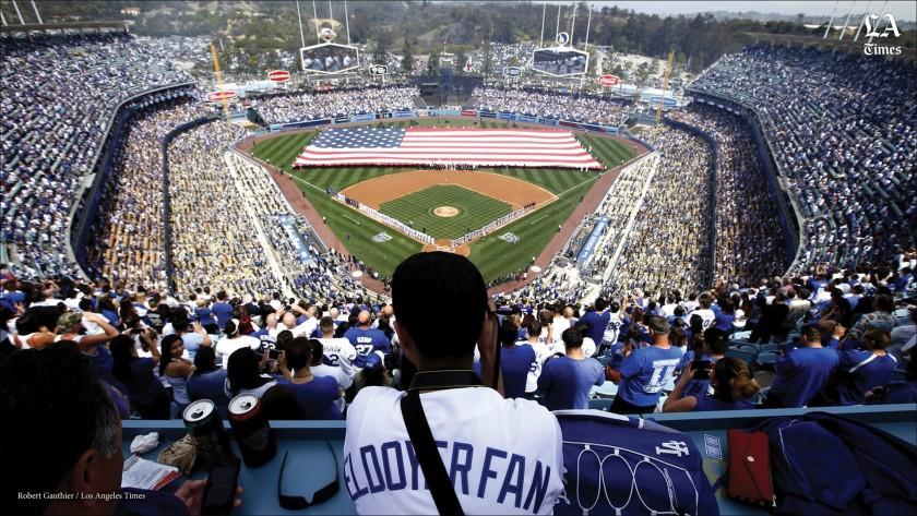 A fan looks on during the pregame ceremony at Dodger Stadium for the Dodgers' home opener against the San Francisco Giants.