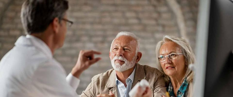 Senior couple having consultations about their supplement pills with a doctor.