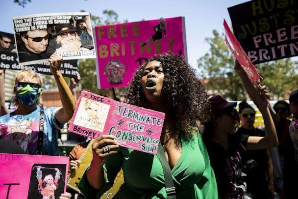 PHOTO:A protester holds a sign reading 'Terminate the conservatorship' as hundreds of people participate in a #FREEBRITNEY rally in front of the court house where Britney Spears appeared remotely in a conservatorship hearing in Los Angeles, June 23, 2021. (Etienne Laurent/EPA via Shutterstock)