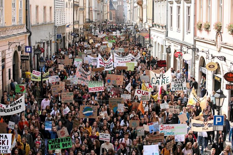 Activists take part in the Global Climate Strike in Krakow