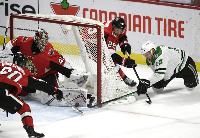 Ottawa Senators goaltender Craig Anderson (41) makes a pad save against a wraparound attempt by Dallas Stars center Radek Faksa (12) during the first period of an NHL hockey game Sunday, Feb. 16, 2020, in Ottawa, Ontario. (Justin Tang/The Canadian Press via AP)