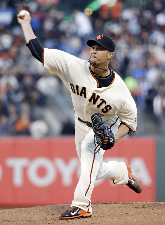 San Francisco Giants starting pitcher Ryan Vogelsong throws to the Los Angeles Dodgers during the first inning of a baseball game on Wednesday, April 16, 2014, in San Francisco. (AP Photo/Marcio Jose Sanchez)
