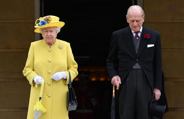 <p>Queen Elizabeth II and Prince Philip, Duke of Edinburgh observe a minute's silence in honour of the victims of the attack at Manchester Arena at the start of a garden party at Buckingham Palace on May 23, 2017 in London, England. (Dominic Lipinski – WPA Pool/Getty Images) </p>