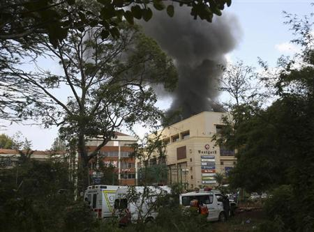 Smoke rises over Westgate shopping centre after an explosion in Nairobi, September 23, 2013. Powerful explosions sent thick smoke billowing from the Nairobi mall where militants from Somalia's al Qaeda-linked al Shabaab group threatened to kill hostages on the third day of a raid in which at least 59 have already died. REUTERS/Karel Prinsloo