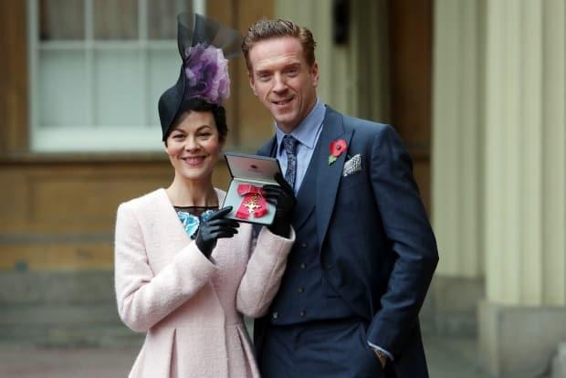 McCrory poses with husband Damian Lewis after she was awarded an OBE (Officer of the Most Excellent Order of the British Empire) by Queen Elizabeth at Buckingham Palace on Nov. 7, 2017 in London, England.
