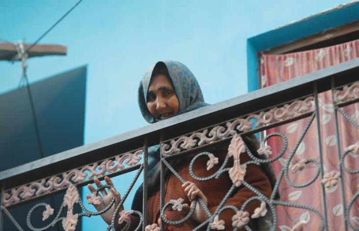 Nafisa, mother of Mohammed Mohsin, who died during clashes with police following protests against a new citizenship law, mourns as she stands in the balcony of their house in Meerut