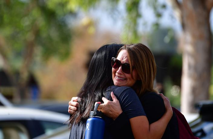 Women embrace in Central Park after a shooting at Saugus High School in Santa Clarita, California on Nov. 14, 2019. (Photo: Frederic J. Brown/AFP via Getty Images)