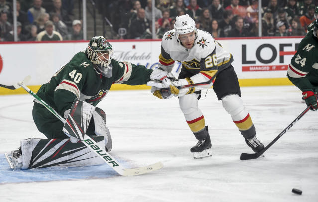 Minnesota Wild goalie Devan Dubnyk (40) pushes off Vegas Golden Knights forward Paul Stastny (26) in the first period during an NHL hockey game Saturday, Oct. 6, 2018, in St. Paul, Minn. (AP Photo/Craig Lassig)