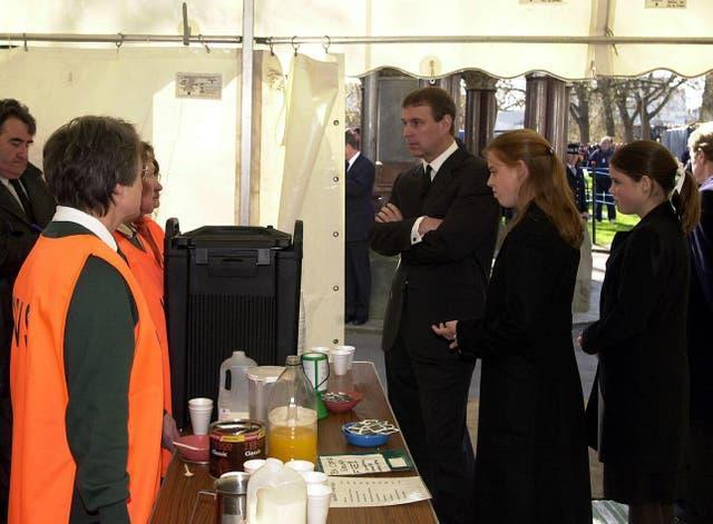 The Duke of York meeting the Women's Royal Voluntary Service, who served refreshments to the public queuing to view the Queen Mother's coffin