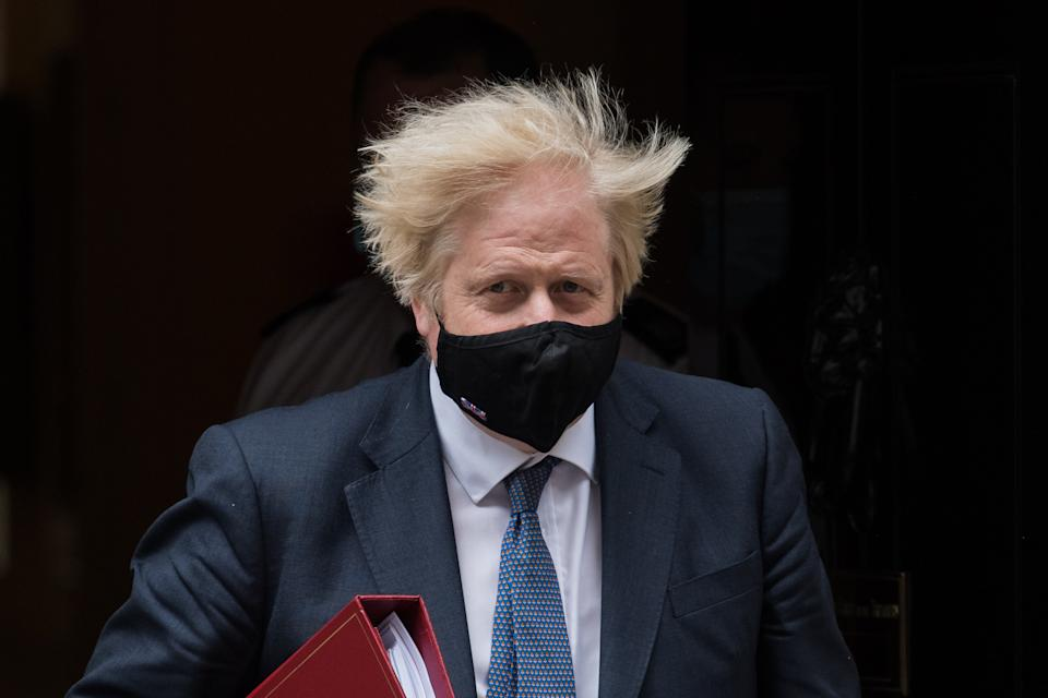 LONDON, UNITED KINGDOM - JUNE 30, 2021: British Prime Minister Boris Johnson leaves 10 Downing Street for PMQs at the House of Commons on June 30, 2021 in London, England. (Photo credit should read Wiktor Szymanowicz/Barcroft Media via Getty Images)