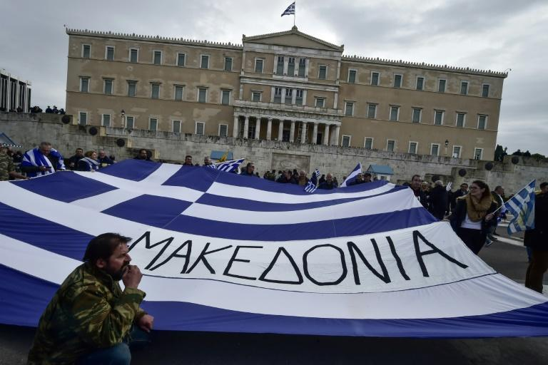 "A Greek flag reading ""Macedonia"" held at a demonstration in Greece earlier this year urging the government not to compromise on the festering name row"