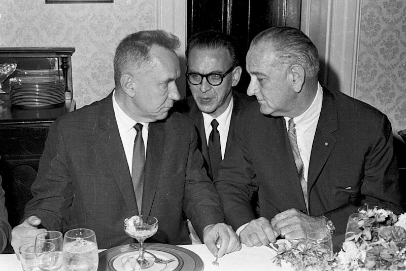 FILE - This June 23, 1967 black-and-white file photo shows Soviet Premier Alexei N. Kosygin, left, meeting with President Lyndon Johnson for a luncheon meeting of the Big Two leaders in Glassboro, N.J. At center is U.S. State Department Interpreter Bill Krimer relaying Johnson's words to the Soviet Premier. The Washington-Moscow Hot Line, used by U.S. and Russian leaders for frank discussions about crises including the 1967 Six-Day War and the Soviet Union's 1979 invasion of Afghanistan, marks its 50th birthday Thursday with the nations still grappling with competing interests in regional conflicts. (AP Photo, File)