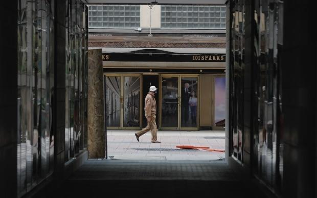 A person walks down an even quieter Sparks Street in Ottawa.  (Andrew Lee/CBC - image credit)