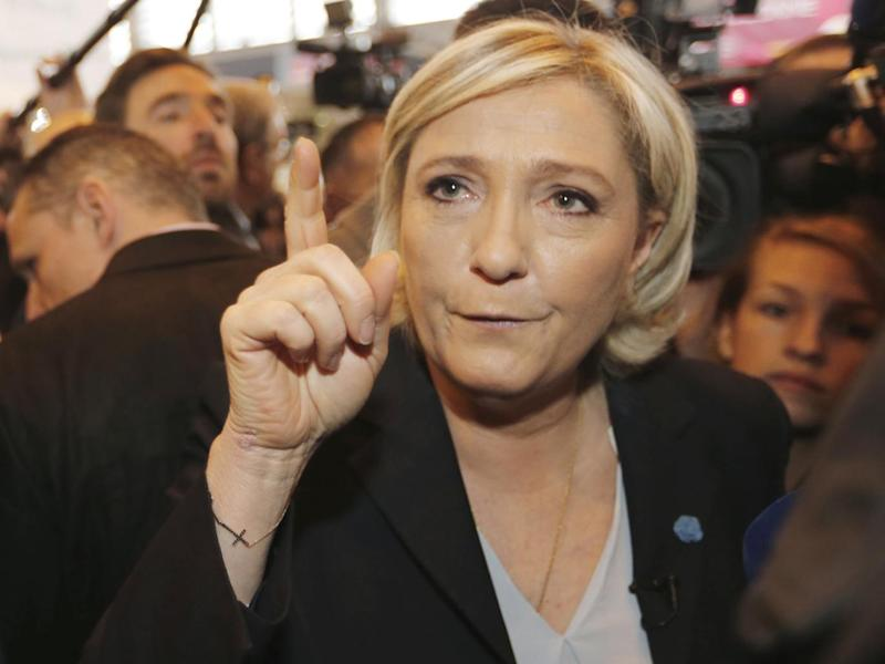 Marine Le Pen has been engulfed by scandals over EU spending and sharing Isis propaganda on Twitter (Reuters)