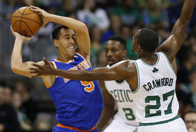 New York Knicks' Pablo Prigioni (9) looks to pass against Boston Celtics' Jordan Crawford (27) as Celtics' Jeff Green helps defend during the first quarter of an NBA preseason basketball game in Manchester, N.H., Saturday, Oct. 12, 2013. (AP Photo/Michael Dwyer)