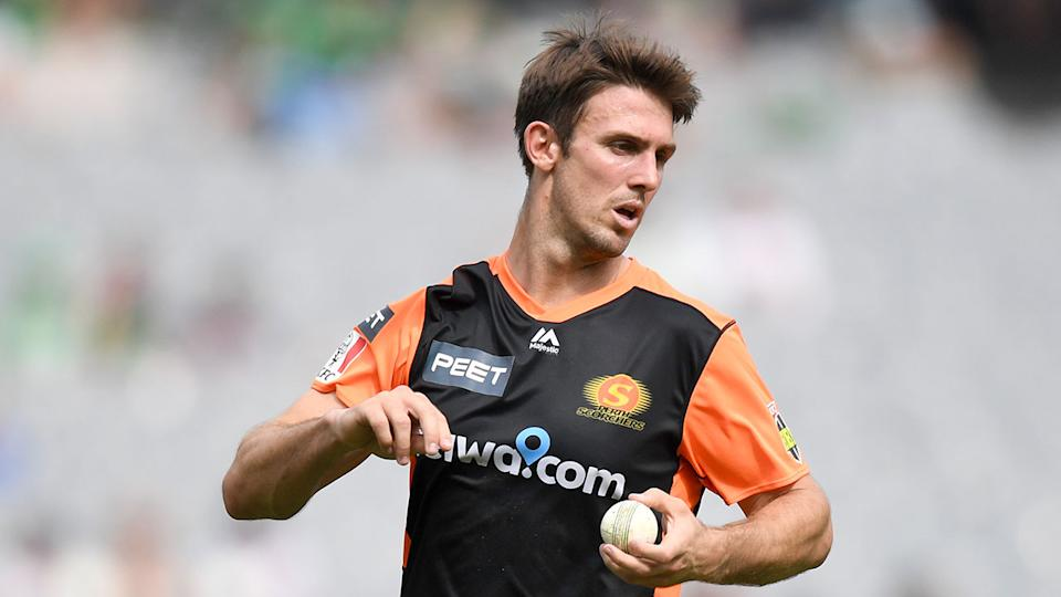 Seen here, Perth Scorchers allrounder Mitch Marsh gets ready to bowl.