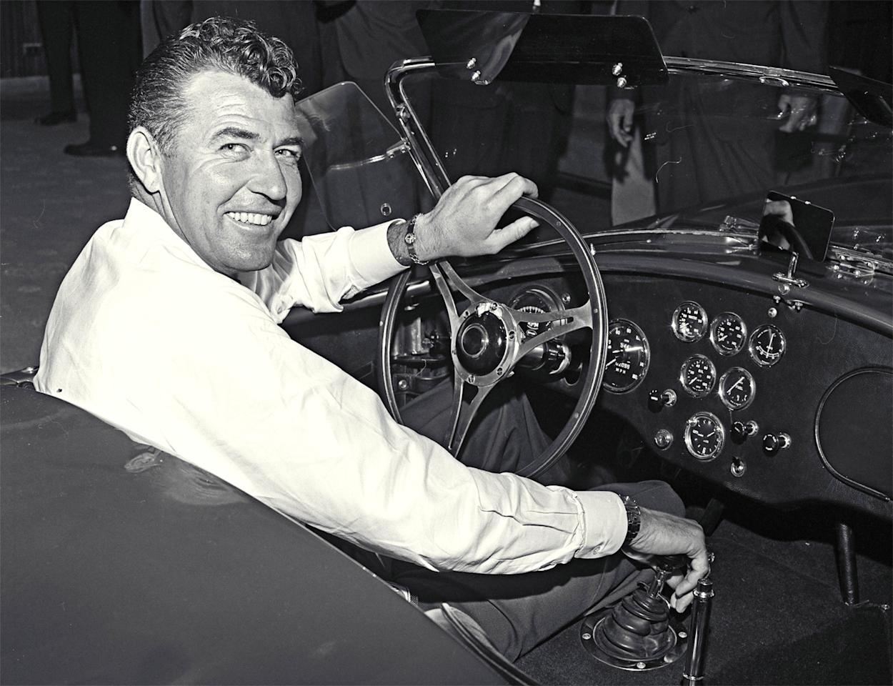 Cobra publicity photo, Venice, CA, 1963. Carroll Shelby at the wheel of a new Cobra production car.