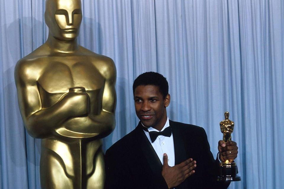 "<p>Denzel Washington proudly held his Best Supporting Actor Oscar backstage after winning for his role in <em><a href=""https://www.amazon.com/dp/B000Q7LUGA?ref=sr_1_1_acs_kn_imdb_pa_dp&qid=1547580118&sr=1-1-acs&autoplay=0&tag=syn-yahoo-20&ascsubtag=%5Bartid%7C10055.g.5132%5Bsrc%7Cyahoo-us"" rel=""nofollow noopener"" target=""_blank"" data-ylk=""slk:Glory"" class=""link rapid-noclick-resp"">Glory</a></em>.</p>"