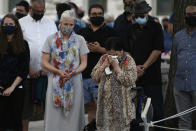 <p>Nazira Naz Tareen, founder and first president of the Ottawa Muslim Women's Organization, wipes her eyes as she stands with Minister of Infrastructure and Communities Catherine McKenna at a vigil for the four family members who were killed in a vehicle attack that police say was motivated by anti-Muslim hate, in London, Ont., in Ottawa, on Tuesday, June 8, 2021. THE CANADIAN PRESS/Justin Tang</p>