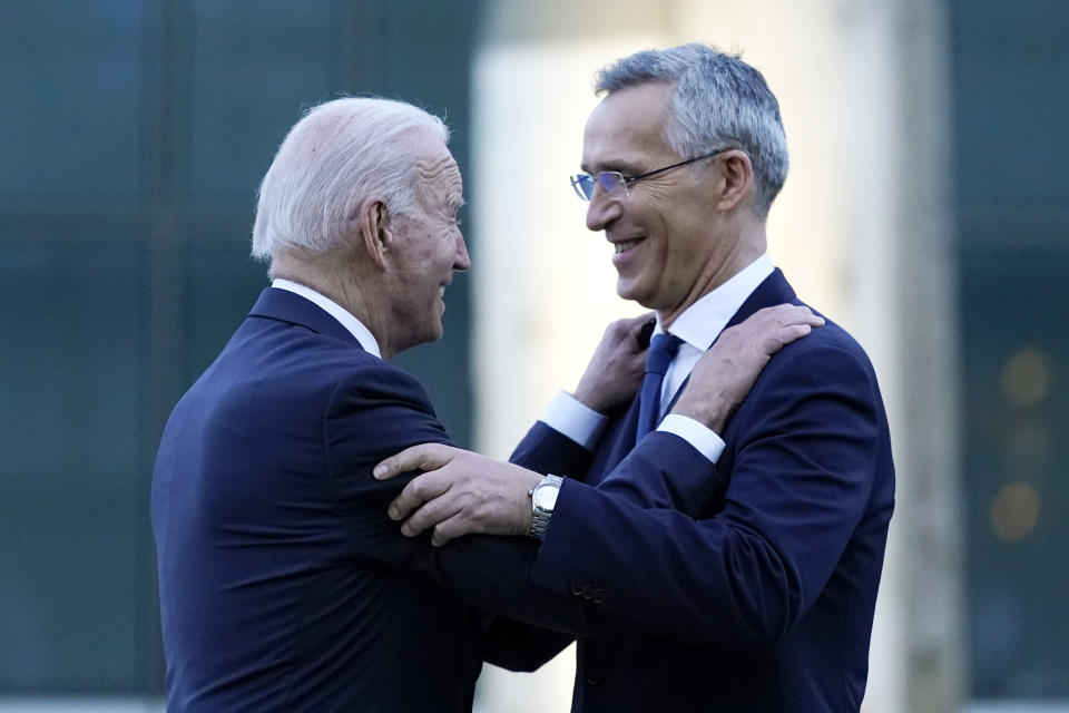 FILE - In this June 14, 2021 file photo, President Joe Biden and NATO Secretary General Jens Stoltenberg speak while visiting a memorial to the September 11 terrorist attacks at NATO headquarters in Brussels. When U.S. President Joe Biden took office early this year, Western allies were falling over themselves to welcome and praise him and hail a new era in trans-Atlantic cooperation. The collapse of Kabul certainly put a stop to that. Even some of his biggest fans are now churning out criticism. (AP Photo/Patrick Semansky, File)