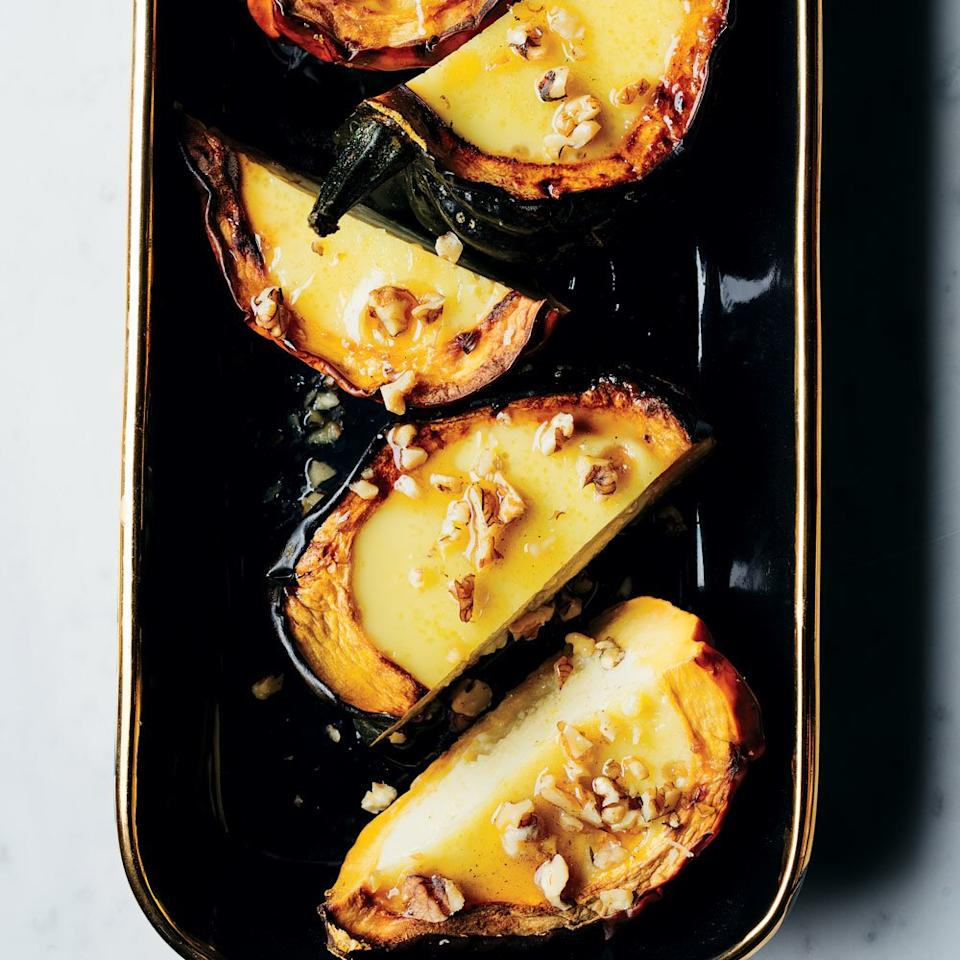 "<p><a href=""https://www.foodandwine.com/contributors/kristen-kish"" target=""_blank"">Kristen Kish</a>'s decadent take on roasted acorn squash is the ultimate Thanksgiving side, but it also works well as an accompaniment to any weeknight meal. The dish itself is simple to put together—it's the waiting that's the hard part.</p> <p> <a href=""https://www.foodandwine.com/recipes/acorn-squash-coconut-custard"">Go to recipe</a></p>"