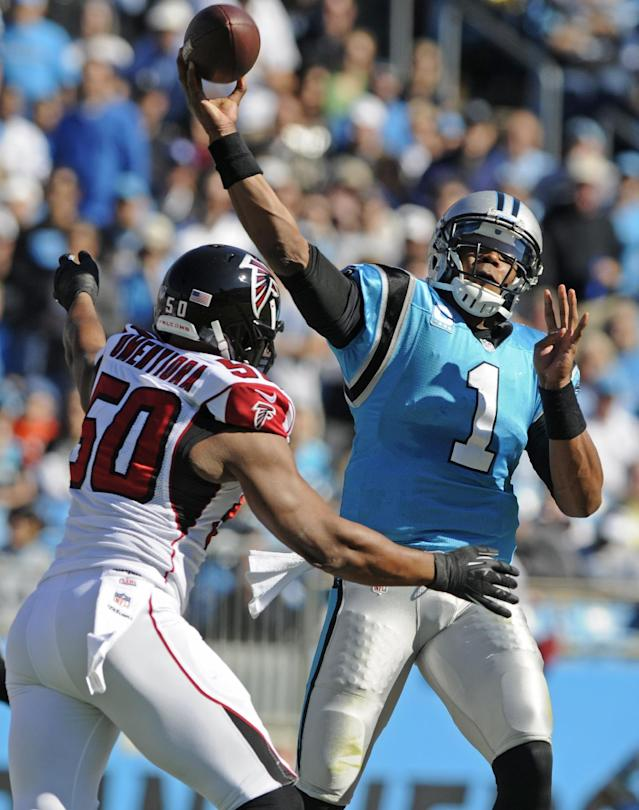 Carolina Panthers quarterback Cam Newton (1) throws a pass under pressure from Atlanta Falcons' Osi Umenyiora (50) in the first half of an NFL football game in Charlotte, N.C., Sunday, Nov. 3, 2013. (AP Photo/Mike McCarn)