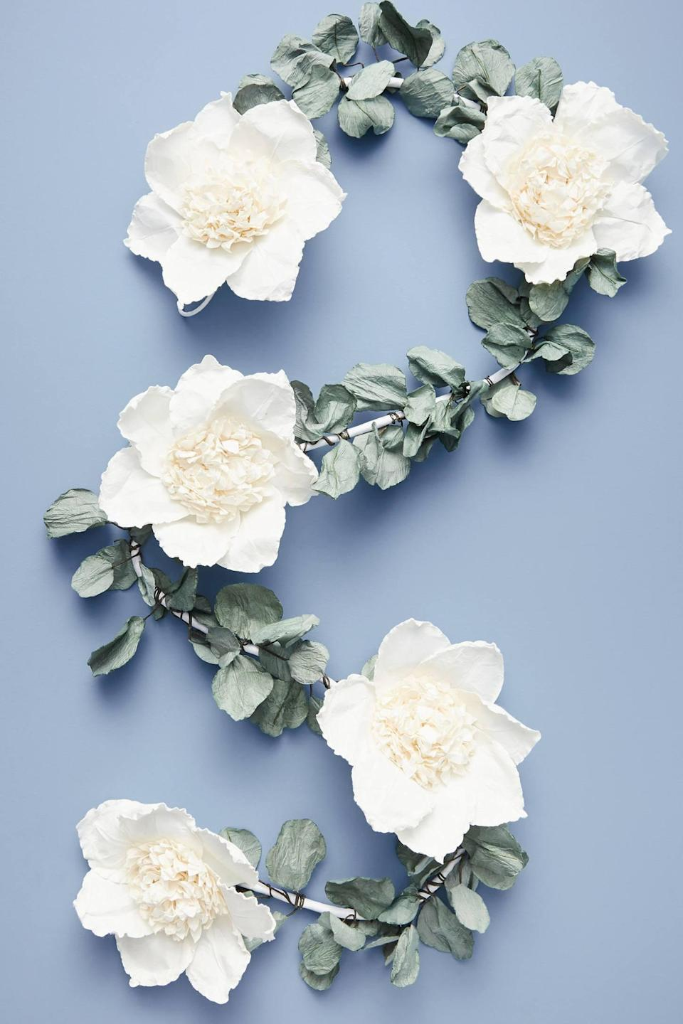 """<p>The <a href=""""https://www.popsugar.com/buy/Eucalyptus-Paper-Garland-490498?p_name=Eucalyptus%20Paper%20Garland&retailer=anthropologie.com&pid=490498&price=78&evar1=casa%3Aus&evar9=46615300&evar98=https%3A%2F%2Fwww.popsugar.com%2Fhome%2Fphoto-gallery%2F46615300%2Fimage%2F46615368%2FEucalyptus-Paper-Garland&list1=shopping%2Canthropologie%2Choliday%2Cchristmas%2Cchristmas%20decorations%2Choliday%20decor%2Chome%20shopping&prop13=mobile&pdata=1"""" rel=""""nofollow noopener"""" class=""""link rapid-noclick-resp"""" target=""""_blank"""" data-ylk=""""slk:Eucalyptus Paper Garland"""">Eucalyptus Paper Garland</a> ($78) is beautiful for a tree, mantel, or even a banister. </p>"""