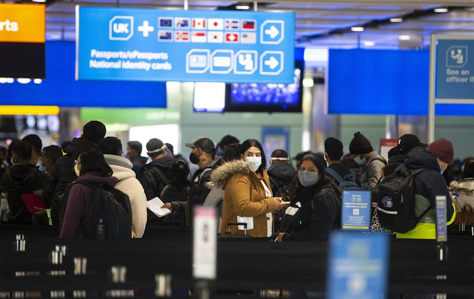 Passengers queue at Heathrow (PA Wire)